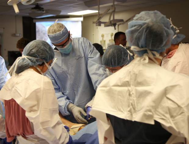 Only a few students remained near the end of the surgery to help put sutures in the cadaver and finish the process.