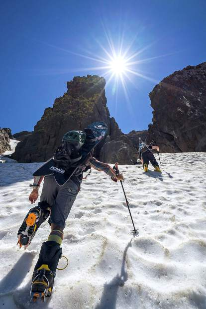 Jeremy Jones, left, and Brennan Lagasse hike up Carson Pass in July 2018 in search of a good summer line.
