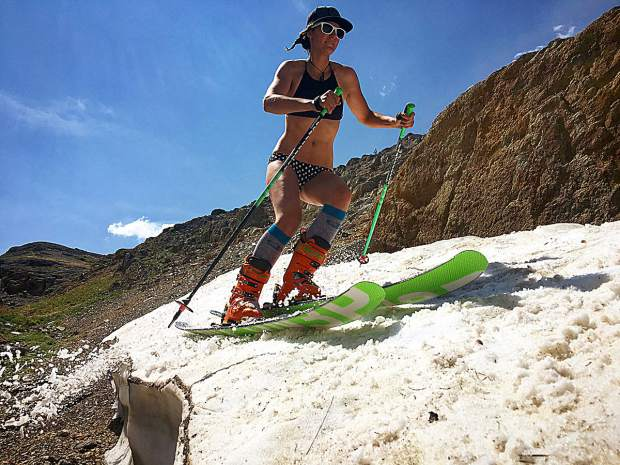 A bikini-clad Alexis Machovsky skis at Carson Pass in July 2018.