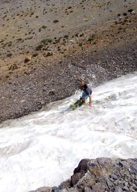 Josh Anderson tears up a small patch of Sierra snow during a previous summer.