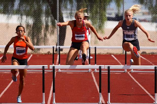 Senior Ava Seelenfreund runs to a gold medal in the 300-meter hurdles.