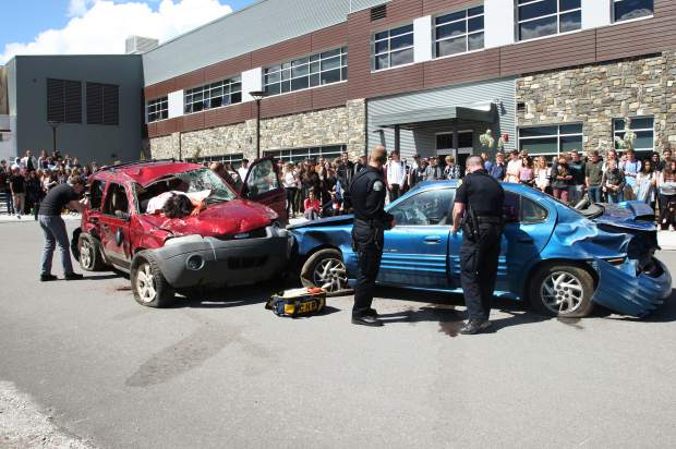 Truckee police officers were the first to arrive on the scene as students left their classes to watch them handle the mock accident.