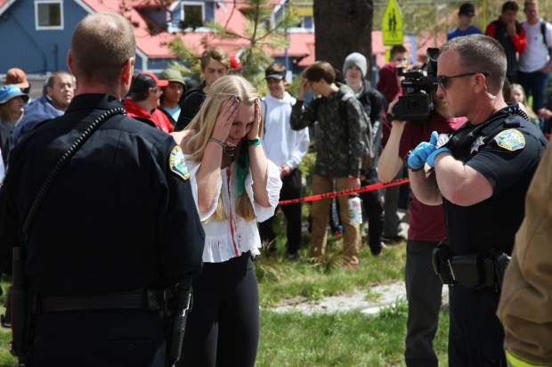 Megan Flynn, the student who posed as a drunk driver, talks with officers as they investigate the mock accident. Truckee High School took part in Every 15 Minutes, a program designed to encourage students to drive responsibly.