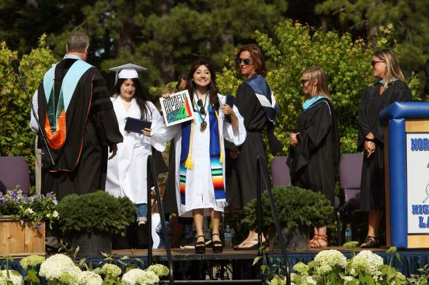 Vanessa Radilla collects her diploma.