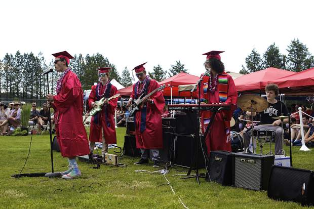 """Ethan Reichwald, Vincenzo Pellegrino, Jack Keith, Harry Rodriguez, and Tyler Corso rock the audience and graduating class with the senior song, """"Float On"""" by Modest Mouse."""