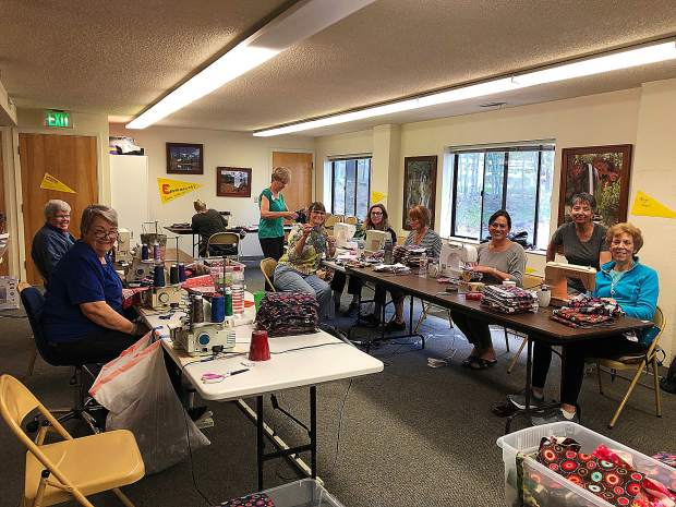 Days for Girls Truckee Team at work this week at the Seventh Day Adventist Church. This group makes feminine hygiene products for girls in Third World countries so that they can attend school. Kudos to all!