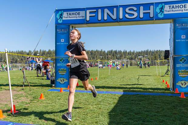 Noosa Higgins, 13, of Tahoe City, wins the 5-kilometer race at Sunday's Truckee Running Festival. Visit LefrakPhotography.com for more race photos.