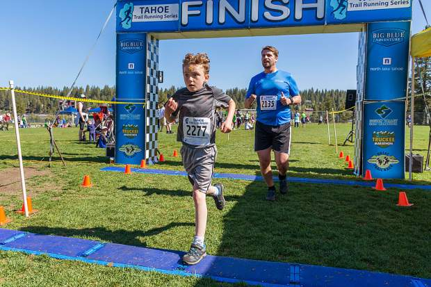 Caiden Reitter, 10, of Truckee crosses the finish line in third place overall at Sunday's Truckee Running Festival. Visit LefrakPhotography.com for more race photos.