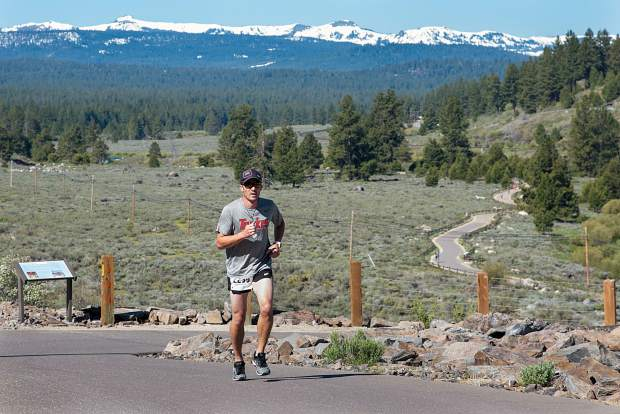 Truckee's Robert McClendon runs along the Legacy Trail during Sunday's 10-kilomter race. McClendon finished third overall. Visit LefrakPhotography.com for more race photos.