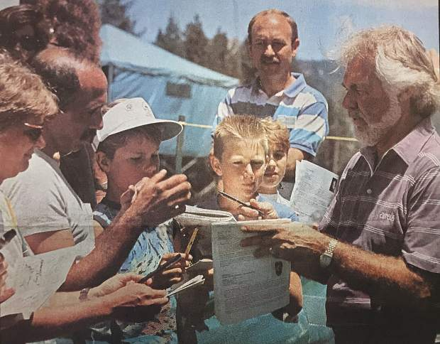 Country music legend Kenny Rogers signs autographs at the inaugural celebrity golf tournament at Lake Tahoe.