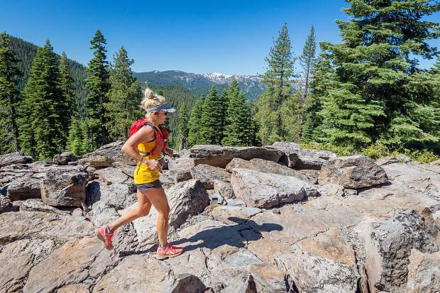 Female winner, Kristin Bohm, of Truckee, runs on the newly opened Big Chief Trail. For more race photos, visit LefrakPhotography.com.