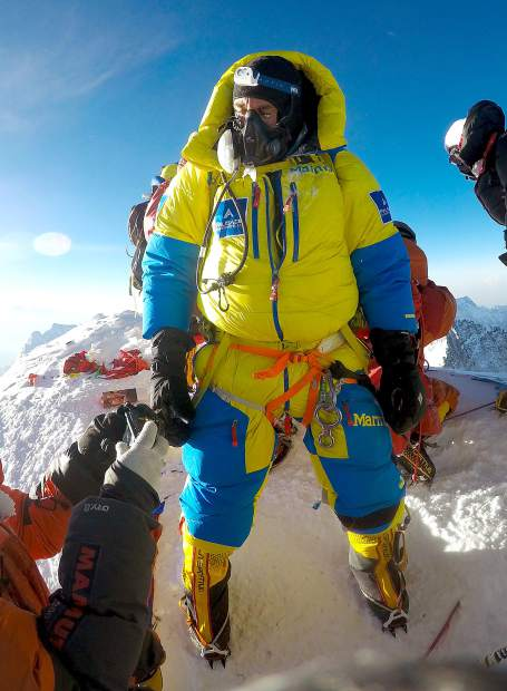 South Lake Tahoe's Robin DeSota stands on the summit of Mount Everest.