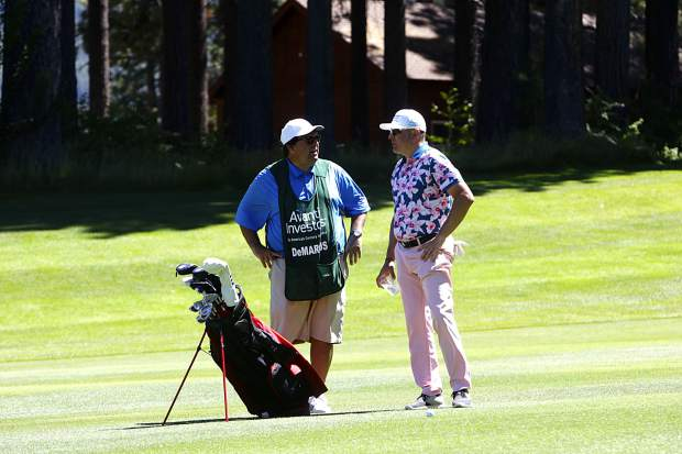 Jay DeMarcus talks things over with his caddy.