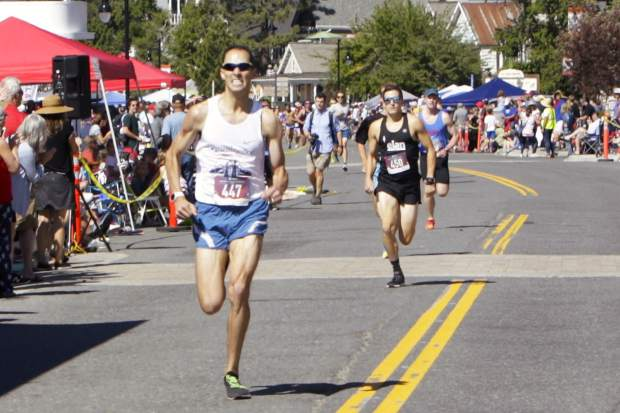 Dominic Henriques, 32, of Reno, finishes in first place at the Firecracker Mile.
