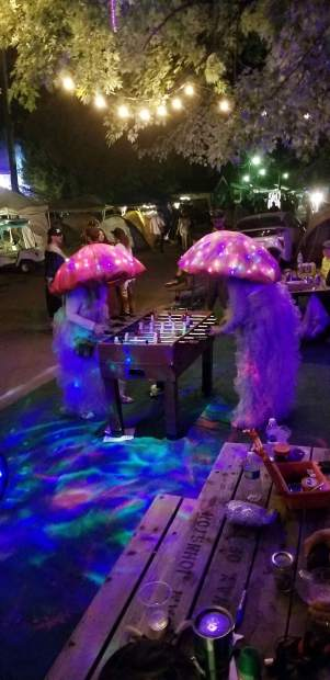 Lisa Yesitis and her friend Debi Portelance play a game of foosball while dressed in their mushroom outfits last year.