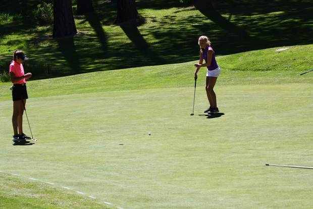 Stella De Wit watches her putt at Tahoe City Golf Course.