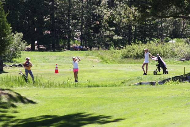 Franny Gramanz watches her shot at Tahoe City Golf Course on June 26.