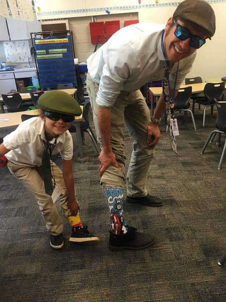 Dynamic duo from Kings Beach Elementary! One student decided to be twins with her favorite principal, Mr. Mohagen, who always has signature socks and hats.