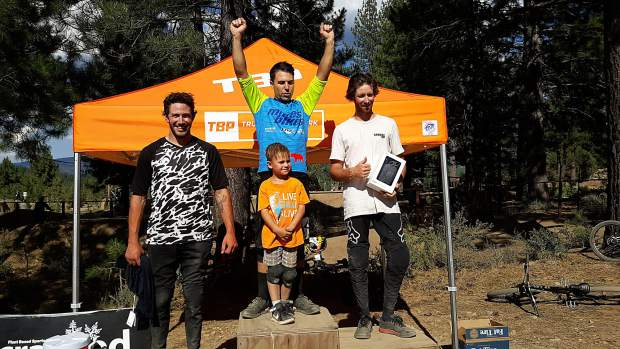 George Stephenson (center) celebrates Saturday's win at the Truckee Bike Park with his 6-year-old son Alister.