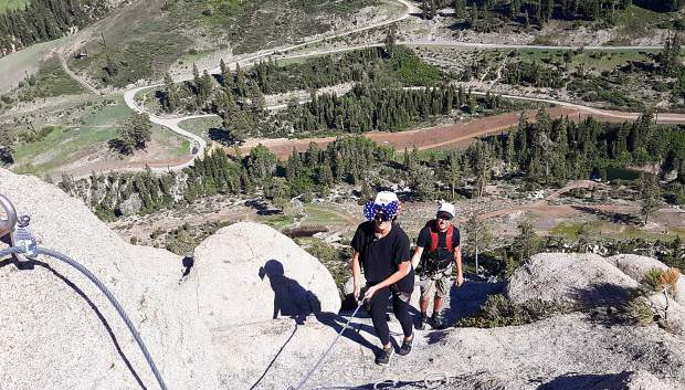 Climbers making their way up the Tahoe Via Ferrata are attached to a cable during all of the climbing portions of the roughly 4-hour trip.