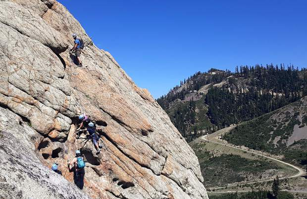 Climbers are guided up Tram Face by Alpenglow Expeditions' guides during the Tahoe Via Ferrata grand opening on Wednesday, July 3 at Squaw Valley.
