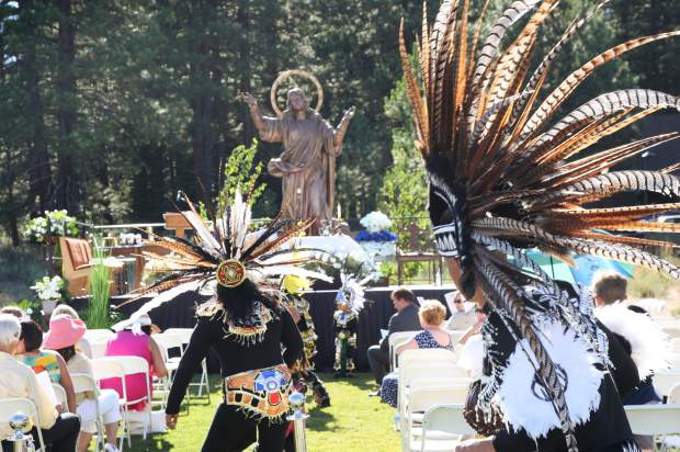 Aztec dancers perform a celebratory dance before the mass began.