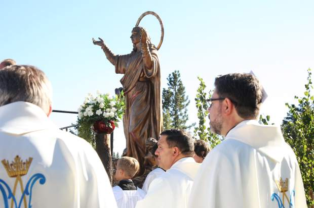 Behind the altar stood the new 15 foot bronze statue portraying the assumption of the blessed Virgin Mary.