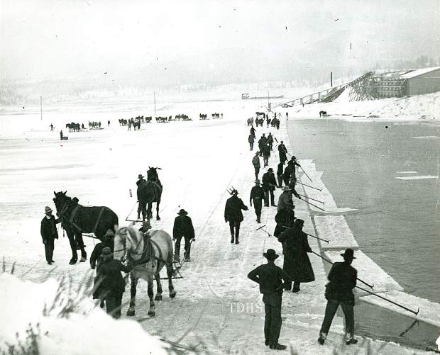 Men and horses harvest ice, circa 1915, at Boca.