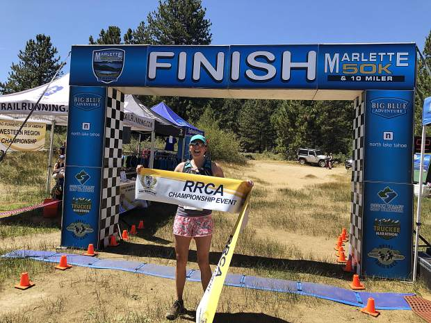 Tahoe City's Jane McClelland celebrates winning the Marlette 50K on Sunday, Aug. 11. For more race photos, visit LefrakPhotography.com.