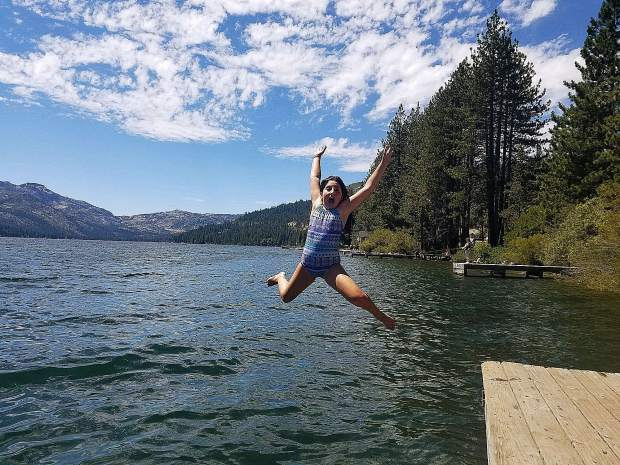 Sierra Sturm, age 9, enjoying her daily jump into the lake.