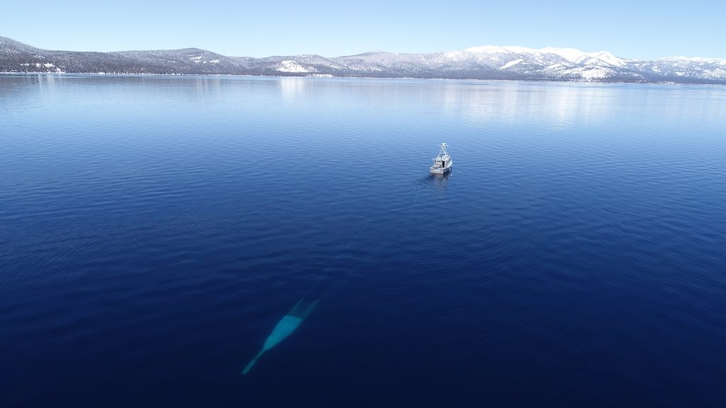 A research vessel from the UC Davis Tahoe Environmental Research Center trawls across the lake.