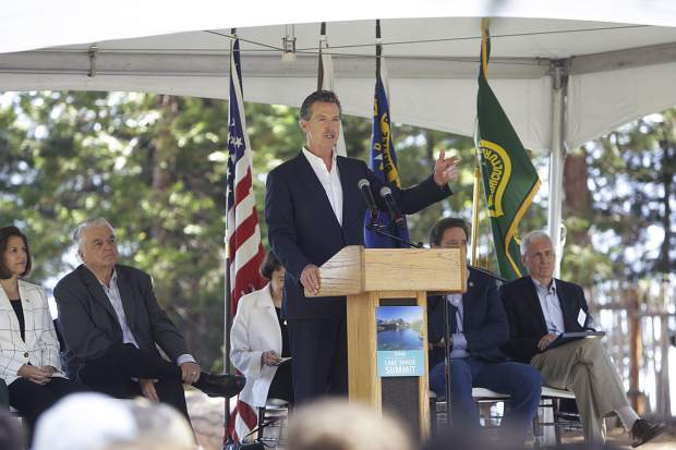 FILE — Gov. Gavin Newsom addresses the crowd during the Lake Tahoe Summit on Tuesday, Aug. 20, 2019.