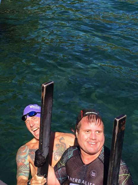 Drew Hunthausen and Greg Smeltzer climb out of the water after one of their legs.