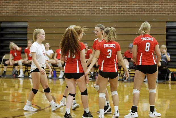 The Wolverines come together after scoring a point near the end of their match against Sparks on Wednesday.