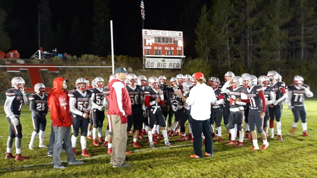 The Truckee football team meets in the end zone after beating Lowry 14-0 on Friday night.