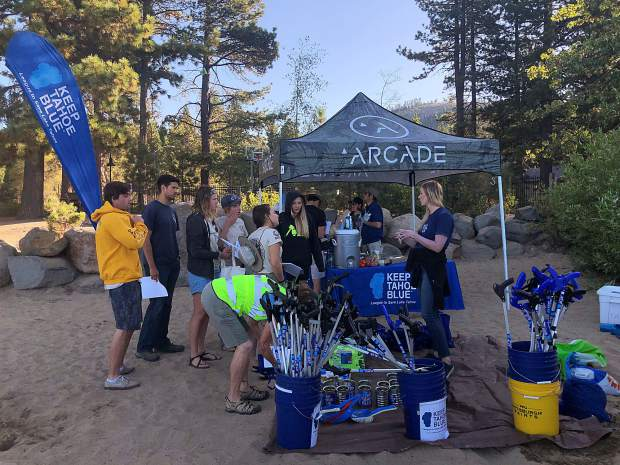 Volunteers removed more than 4,700 pieces of single-use plastic and cigarette butts from Kings Beach on Monday.