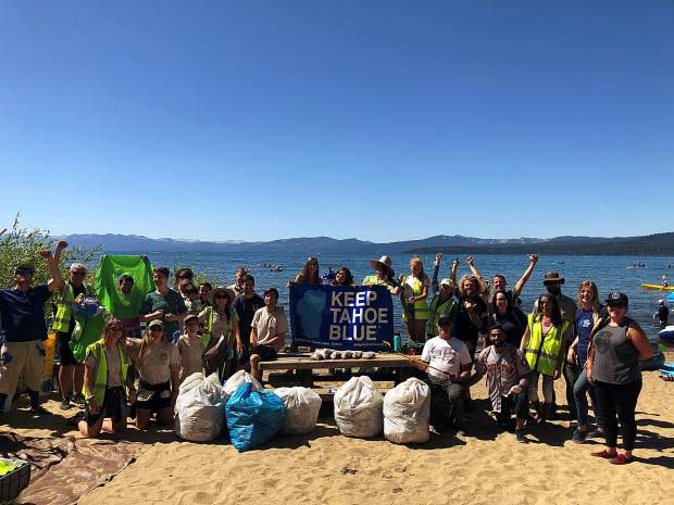 Dozens of volunteers showed up at Kings Beach on Monday to pick up trash left over from the holiday weekend.