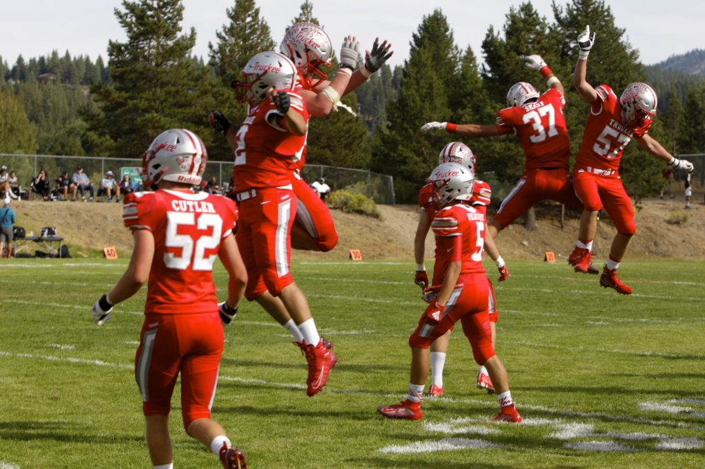 Truckee players celebrate a 17-13 win against North Valleys on Saturday, Sept. 7.