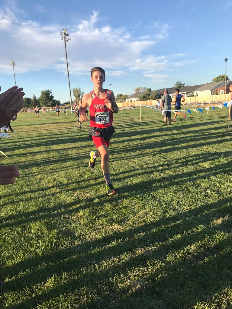 Canyon Blassingame competes in the junior varsity race at the Nevada Twilight Classic.