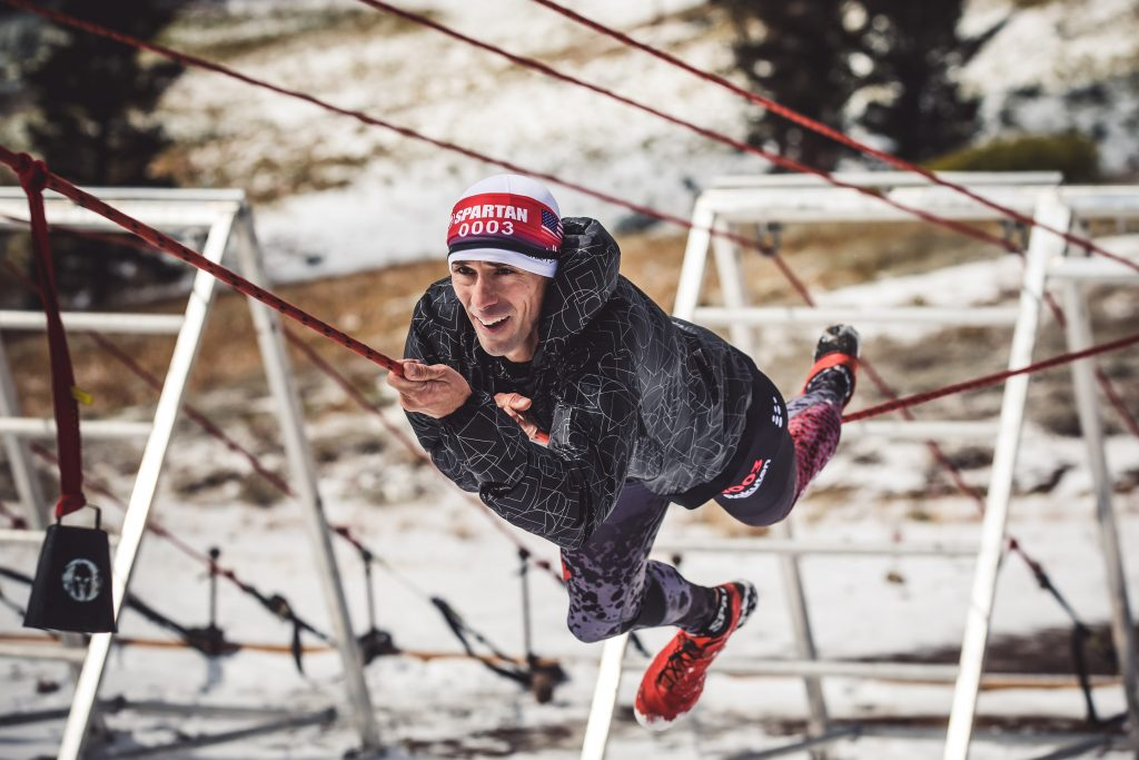Men's champion Robert Killian moves across an obstacle at the Spartan World Championship at Squaw Valley.
