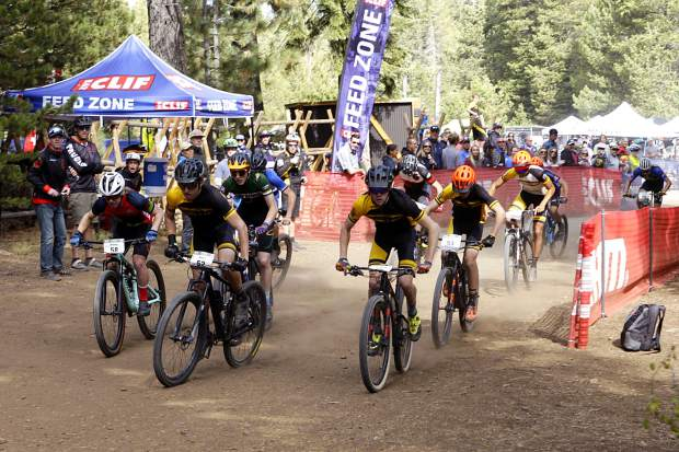 The varsity boys take off from the start of the state championships. Truckee sophomore Matt Seline (58) takes the outside around the opening turn.