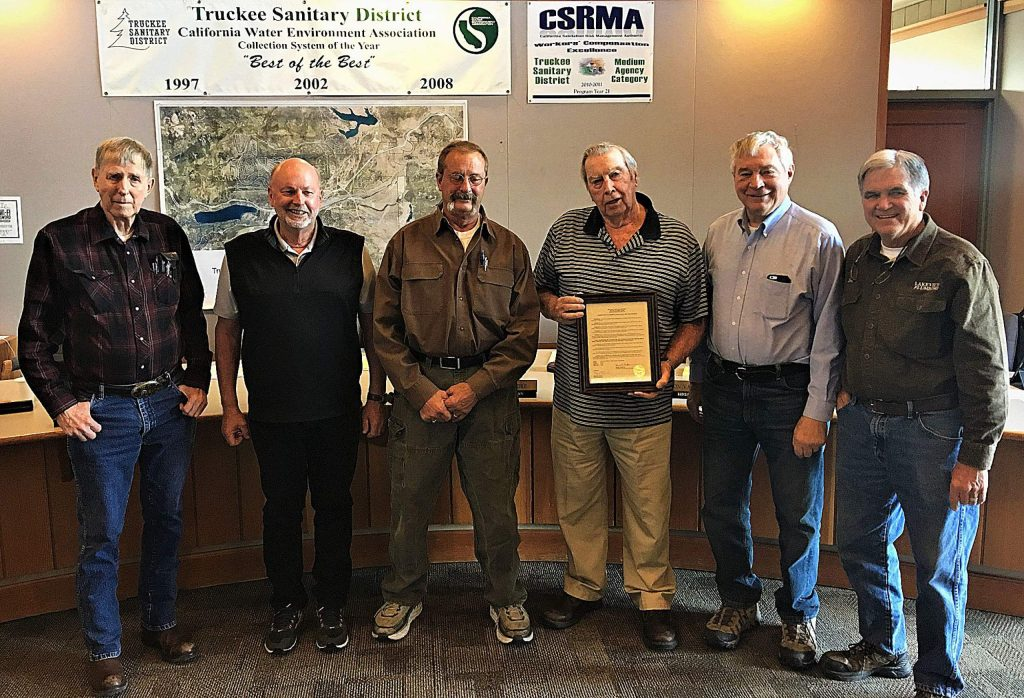 "Truckee Sanitary District held a ceremony during its October meeting to recognize the lifetime accomplishments of its former general manager, Ossian ""Oz"" Butterfield. The board was photographed with Butterfield, center with frame, in April 2018."