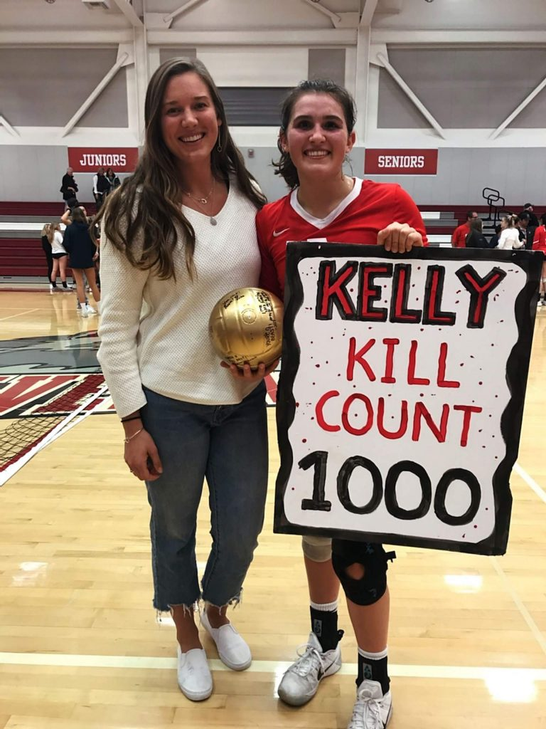 Kelly Cross and Truckee alumna Mackenzie Redner celebrate Cross reaching 1,000 career kills.