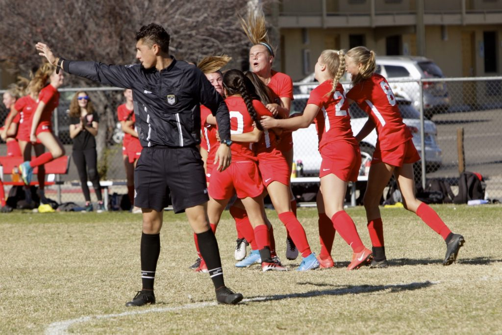 Truckee celebrates scoring a goal against South Tahoe in the state title game.