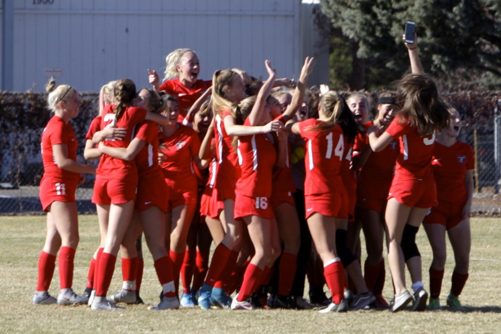 The Truckee girls' soccer team celebrates winning the state championship.
