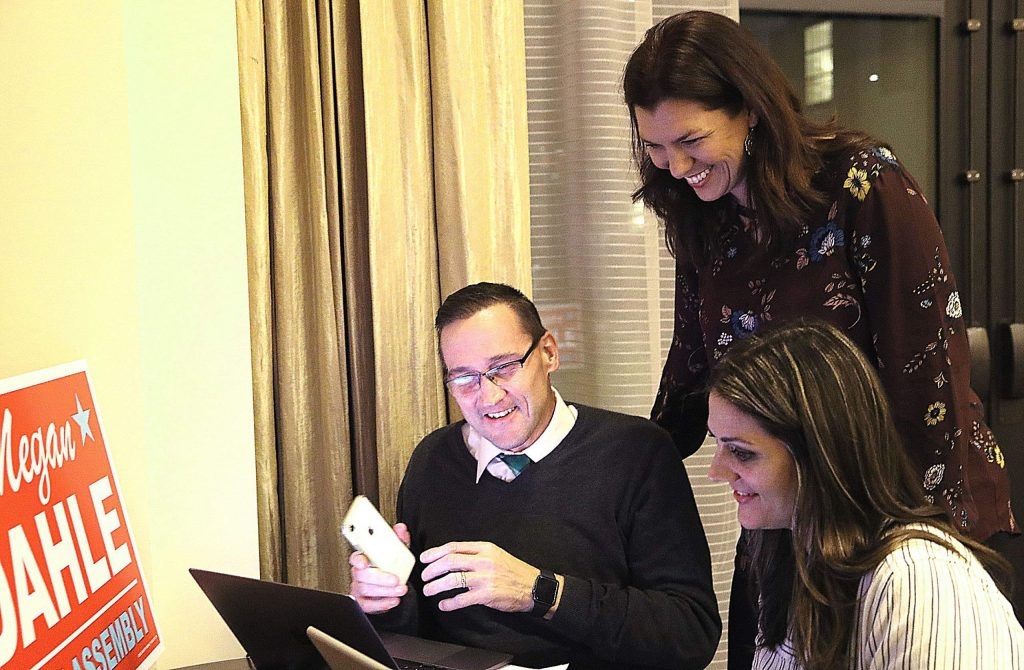 Republican Megan Dahle, standing, checks results with campaign volunteers Josh Cook, left, and Tenessa Audette, right, at her election night party in Redding, Calif., Tuesday, Nov. 5, 2019. Dahle faced Democrat Elizabeth Betancourt for an Assembly seat in District 1. (Michael Chapman/The Record Searchlight via AP)