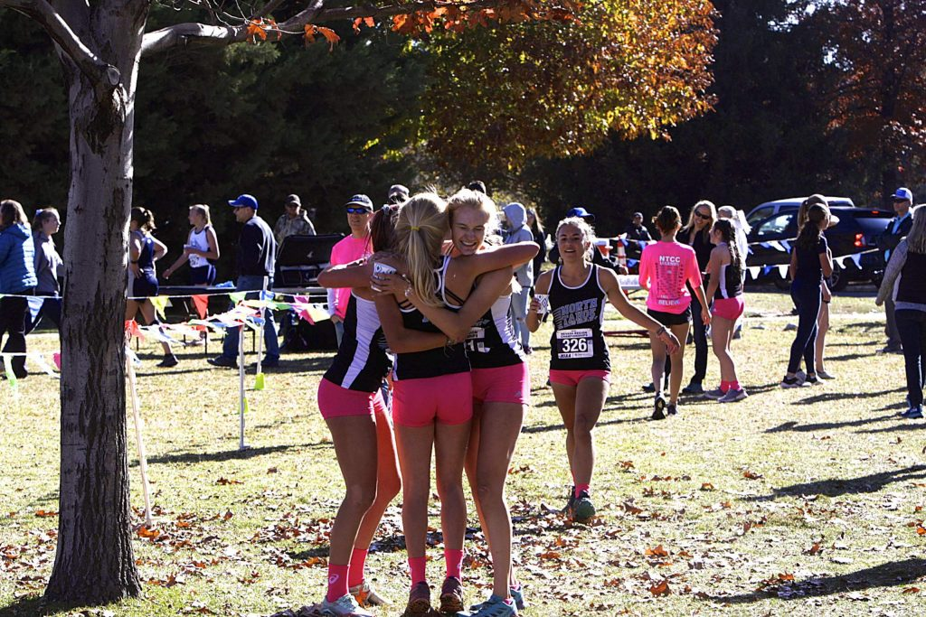 North Tahoe's runners embrace after finishing the Northern League championships on Saturday, Nov. 2.