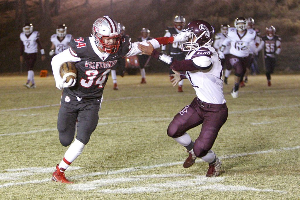 Junior Jackson Ellermeyer stiff arms an Elko defender during the team's win on Friday night, Nov. 1.