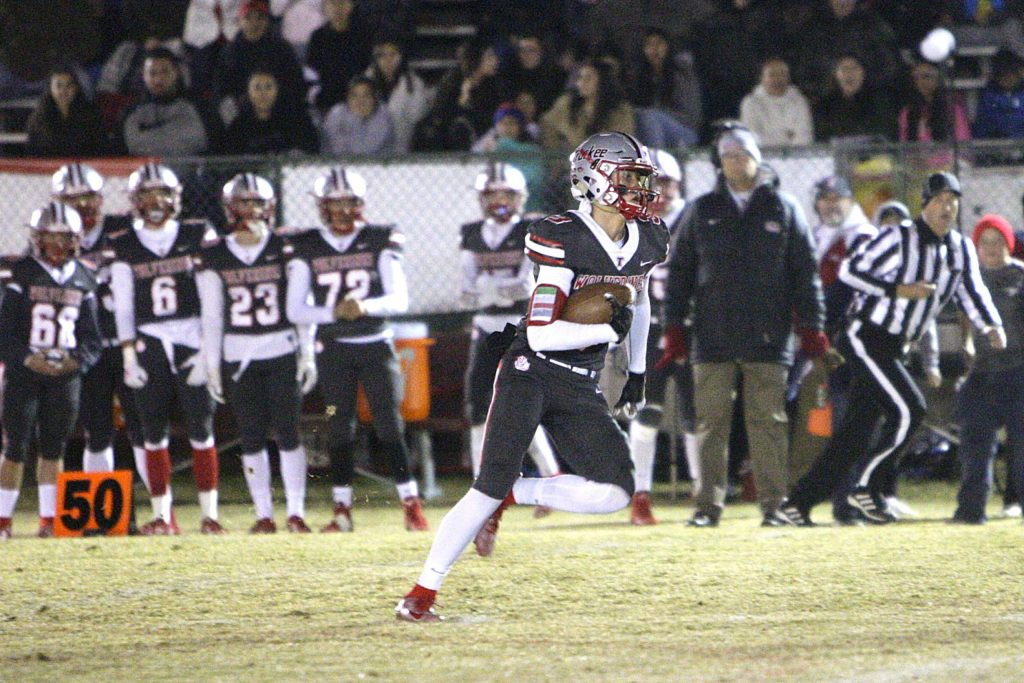 Senior Isaac Cruz picks up some yards after catch against Elko on Friday, Nov. 1.
