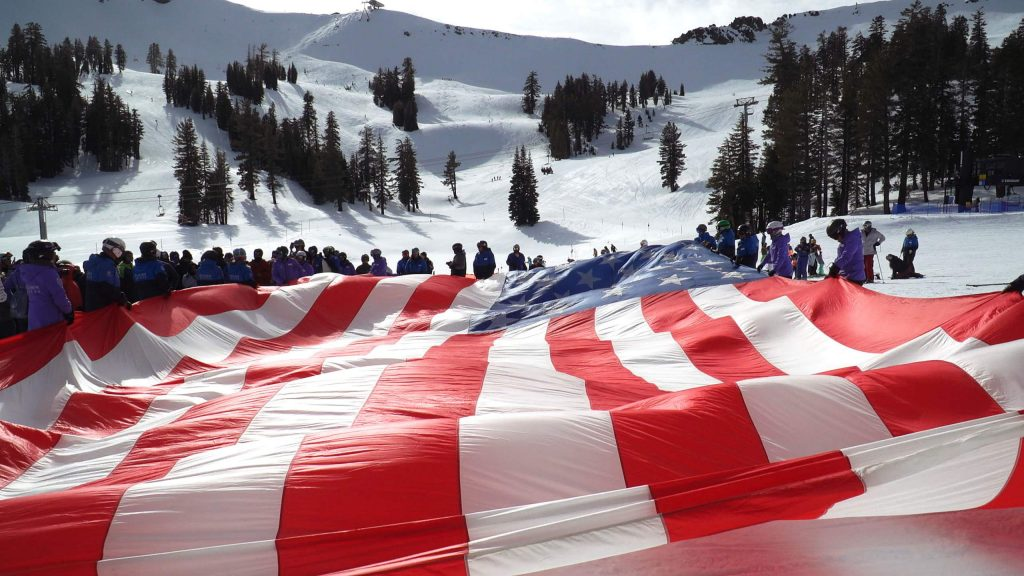 On Friday, Jan 24, during the Anthem Winter Ski Fest, the instructors from Achieve Tahoe skied down a 40- foot American flag at Squaw Valley.